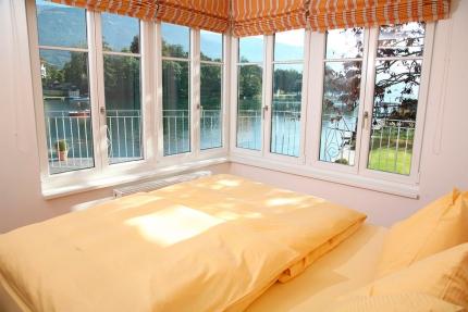 Seevilla Cattina – Schlafzimmer im Appartement Wasserstern – Appartements am Millstätter See in Kärnten – Urlaub in Kärnten am See